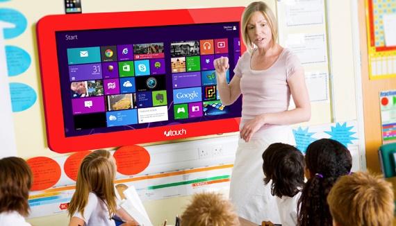 A teacher teaching a junior school class
